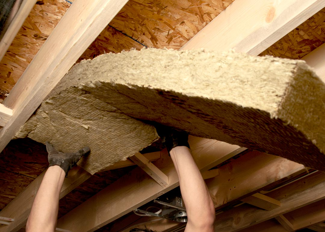 Ceiling batt insulation being installed by Riverhead Building Supply PROInstall professional