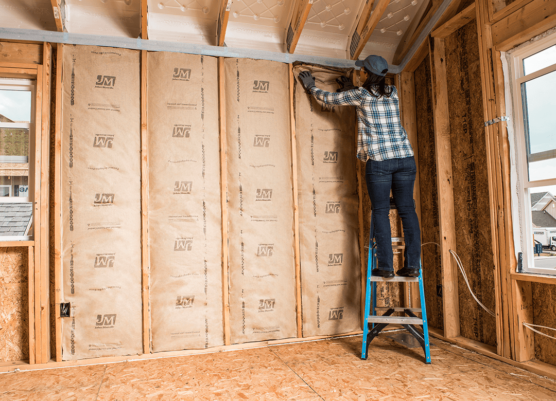 rbs worker setting up insulation in room